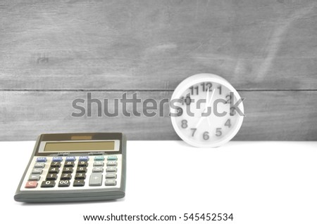 architecture and interior caculate cost and set alarm clock with old wooden background.