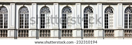 Architecture and windows of ancient renaissance style classical building - stock photo