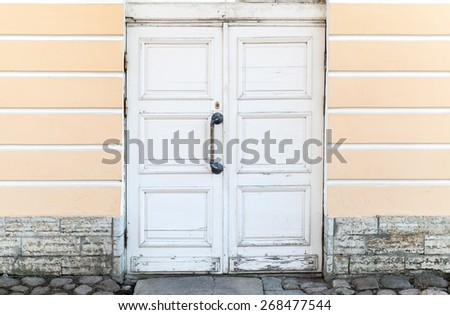 Architecture background. Old white wooden door in classical building facade, St. Petersburg, Russia - stock photo