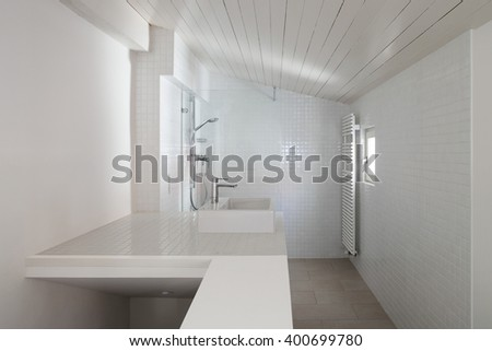 Architecture, bathroom of old loft, tiled walls - stock photo