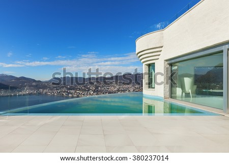 Architecture, beautiful modern house with infinity pool, exterior - stock photo