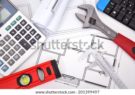 Architecture blueprint and work tool on table
