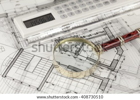 architecture blueprints -  house plans, electronic calculator & magnifying glass
