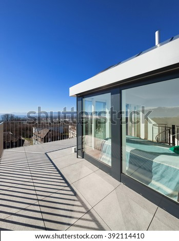 Architecture, bright terrace of a penthouse, blue sky - stock photo