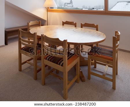 Architecture, comfortable chalet, wooden dining table  - stock photo