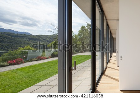 Architecture, corridor of modern building, windows overlooking the garden - stock photo