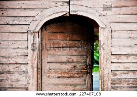 Architecture detail with a very old wooden house front door  - stock photo