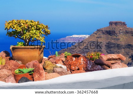Architecture details with a view of the caldera in Fira village, Santorini, Greece - stock photo