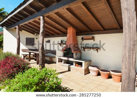 architecture, house old style, porch with fireplace, outdoor - stock photo