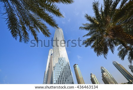 Architecture in Dubai Marina skyscrapers in UAE. View with palms - stock photo