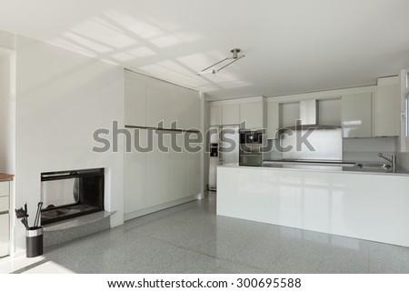 Architecture, interior of a modern house, white kitchen - stock photo