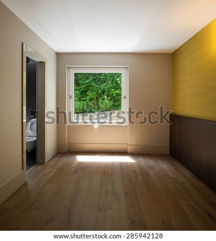 Architecture, interior of empty room with window, parquet floor
