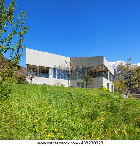 Architecture modern design, concrete house and meadow, outdoors