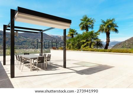 architecture, modern house, beautiful veranda overlooking the lake - stock photo