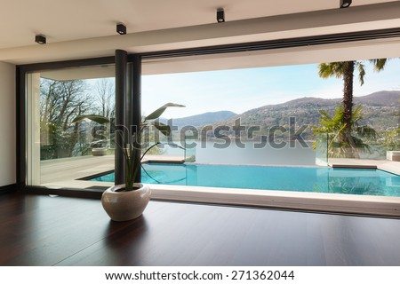 architecture, modern house, pool view from the living room - stock photo