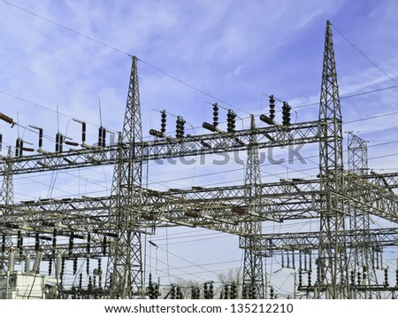 Architecture of electricity: Part of electrical substation with steel lattice structures - stock photo