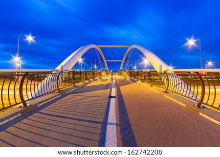 Architecture of highway viaduct at night in Gdansk, Poland - stock photo