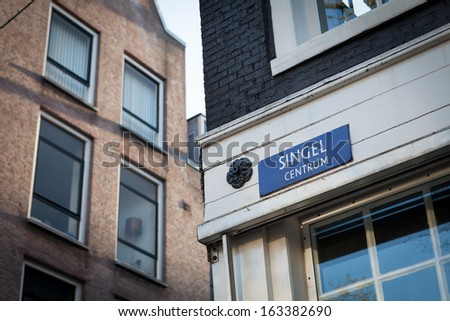 Architecture of houses alongside of Singel channel, Amstredam, Netherlands - stock photo