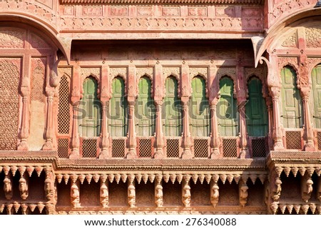 Architecture of India. Front of the old mansion with beautiful stone balconies in Rajasthan. - stock photo