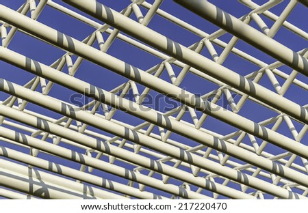 Architecture of metal structure texture against on blue sky