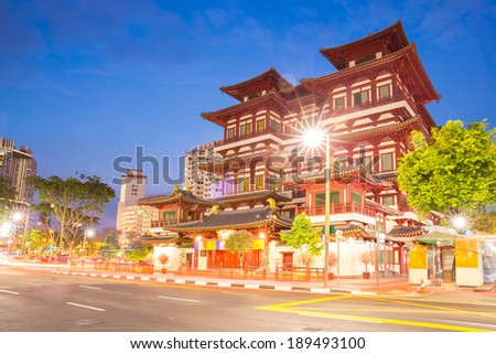 Architecture of Singapore buddha tooth relic temple at dusk - stock photo
