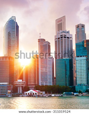 Architecture of Singapore Downtown Core at sunset - stock photo