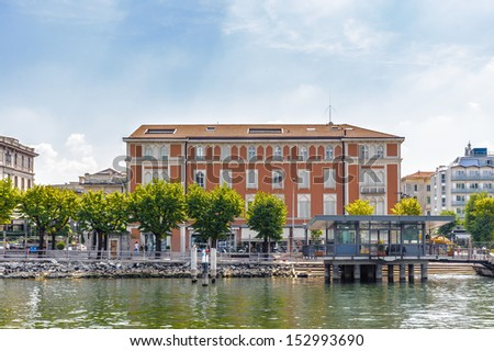 Architecture of the city of Como over the Lake Como, a lake of glacial origin in Lombardy, Italy. - stock photo