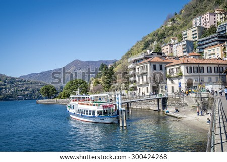 Architecture of the city of Como over the Lake Como, a lake of glacial origin in Lombardy, Italy. 25.04.2015 - stock photo