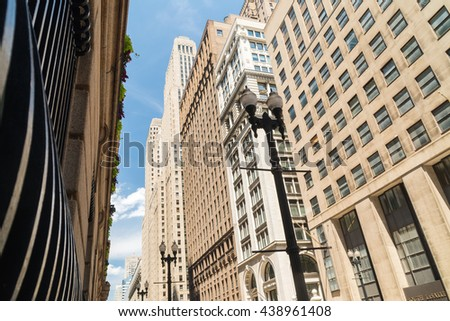 Architecture on LaSalle St. as the sign lights the exterior.  Chicago, Illinois, U.S.A.. - stock photo