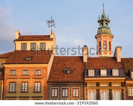 Architecture on the Warsaw's Old Town Market Place on a late summer afternoon. - stock photo