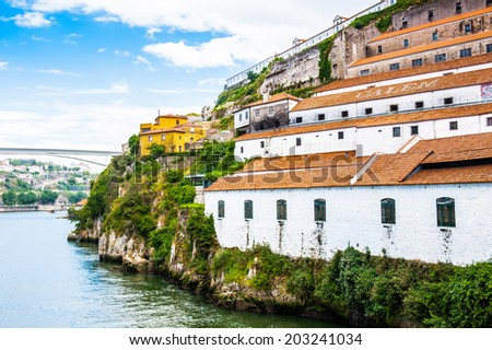 Architecture over the coast of the River Douro in Porto, Portugal. View from the River Douro, one of the major rivers of the Iberian Peninsula (2157 m) - stock photo