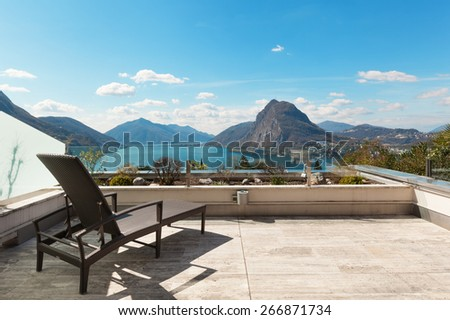 Architecture, penthouse, panoramic terrace with lake view - stock photo