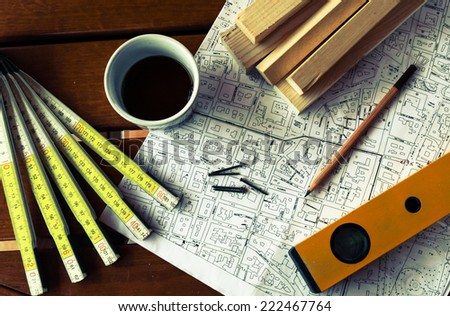 Architecture rolls architectural plans project architect blueprints - stock photo