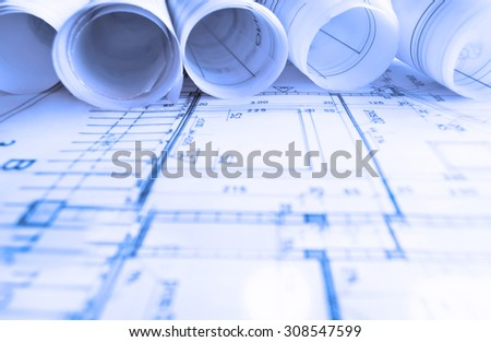 Architecture rolls architectural plans project architect stock architecture rolls architectural plans project architect blueprints real estate concept malvernweather Images