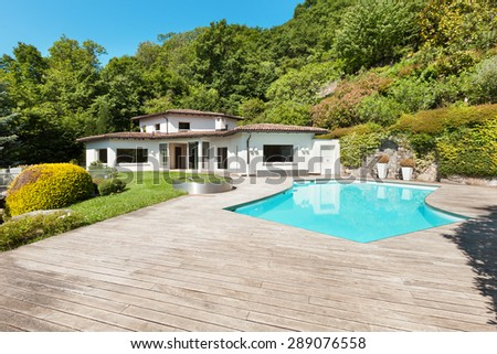 Architecture, villa with swimming pool, outdoors - stock photo