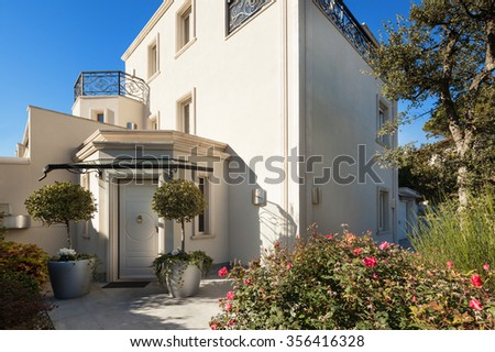 Architecture, white facade of a luxury house, entry door - stock photo