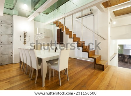 Architecture, wide loft with modern furniture, dining room - stock photo