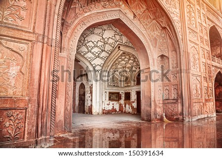 Architecture with carved arches in Red Fort, Old Delhi, India - stock photo