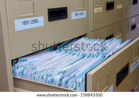 Archive cabinet with open drawer - stock photo