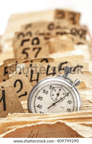 Archive file folders in drawer with stopwatch - stock photo
