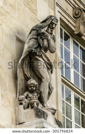 Archives Nationals (National Archives) has been located since 1808 in a group of buildings comprising in district of Le Marais. Sculptures of the facade. - stock photo