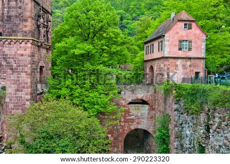 Archway and Renovated Portion of Historic Heidelberg Castle in Lush Green Hills of Baden-Wurttemberg, Germany - stock photo