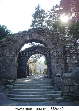 Archway entrance to the Round tower Glendalough, Wicklow Mountains, Ireland - stock photo