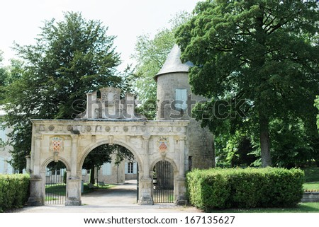 Archway in some gardens in a French Town