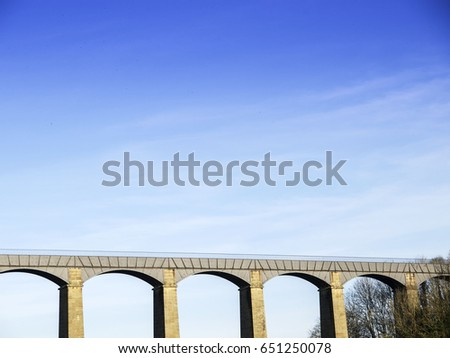 Archways of roman viaduct near Chirk with blue sky in Wales, UK