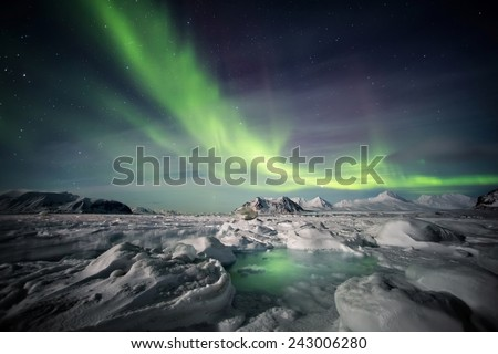 Arctic Archipelago of Svalbard - Northern Lights - stock photo