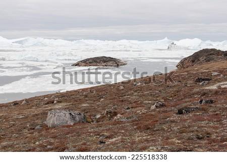 Arctic landscape in Greenland around Disko Island with icebergs - stock photo