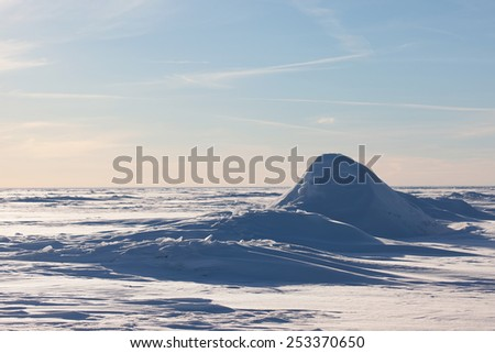 Arctic landscape. The ridges in the icy sea, snowy hills on a frozen plain - stock photo