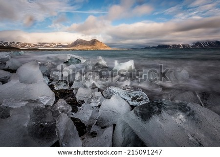 Arctic landscape with ice on the beach (long exposure)