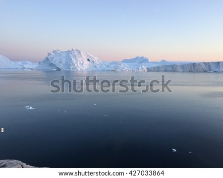 Arctic ocean in Greenland. Iceberg and glaciers are melting on Icefiords - stock photo
